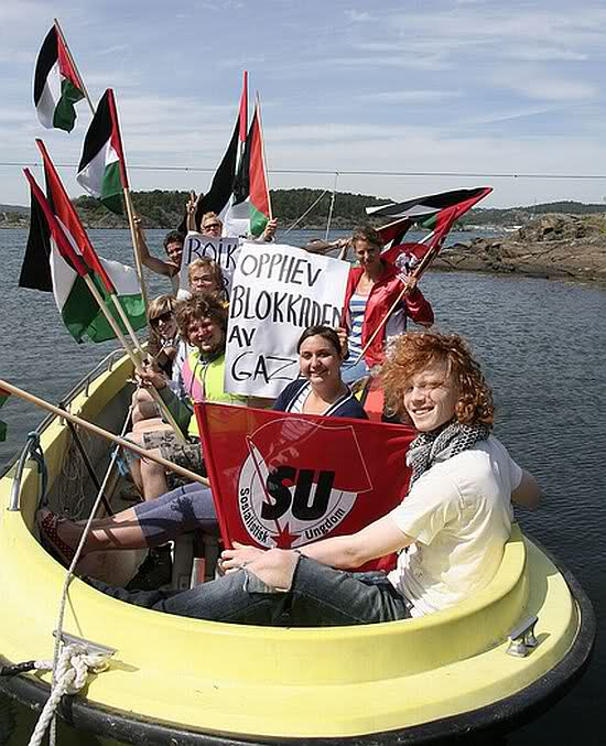 The sign in the photo reads: opphev blokkaden av = overcome the blockade of Gaza